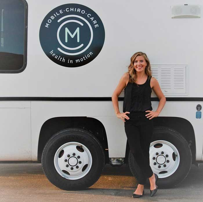 Dr Dena Amato in front of Mobile Chiro Care RV